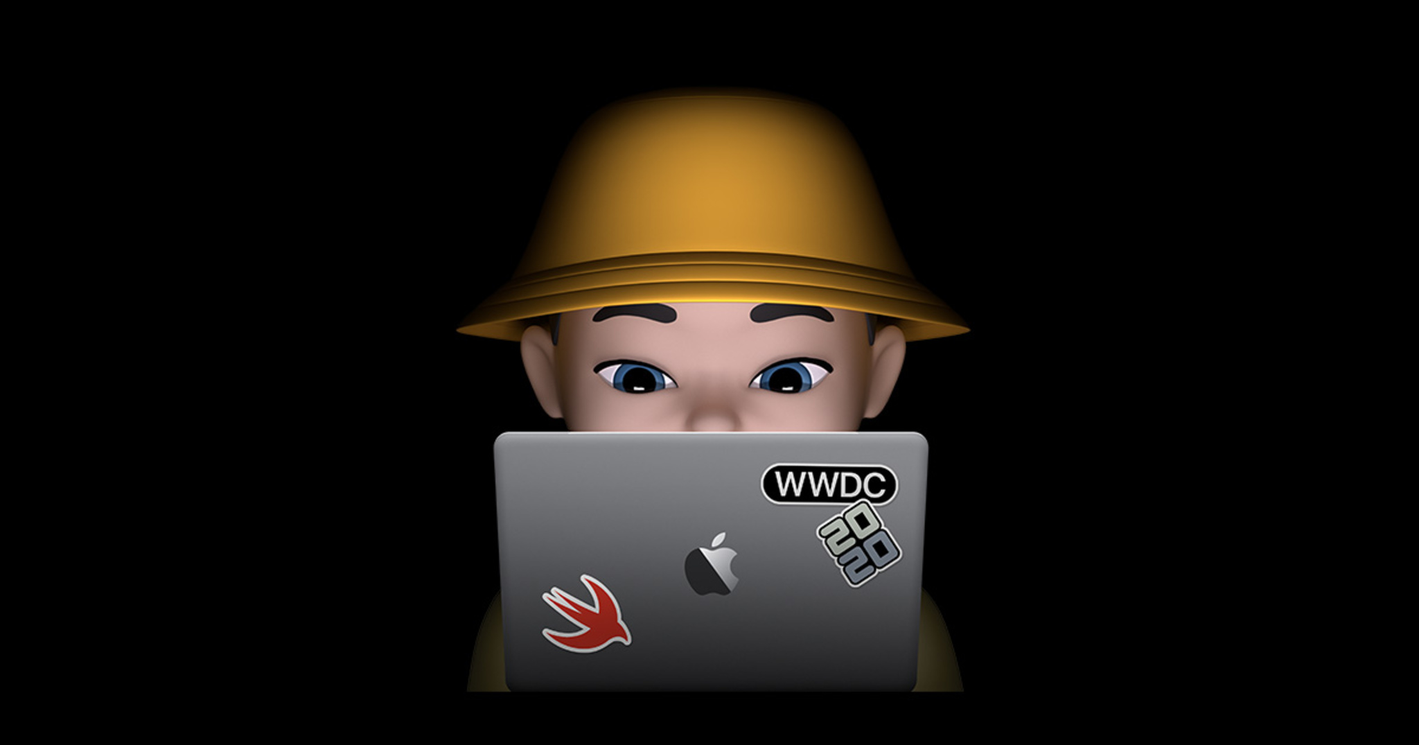 Memoji developer sitting behind MacBook Pro