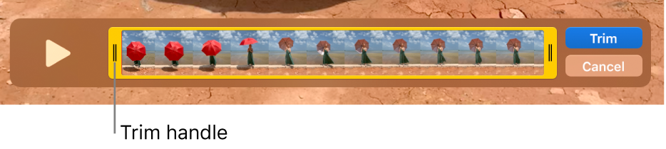 A clip in the QuickTime Player window, showing part of the clip enclosed in the yellow handles, and the rest of it outside the yellow handles. The Trim button and the Cancel button are on the right.