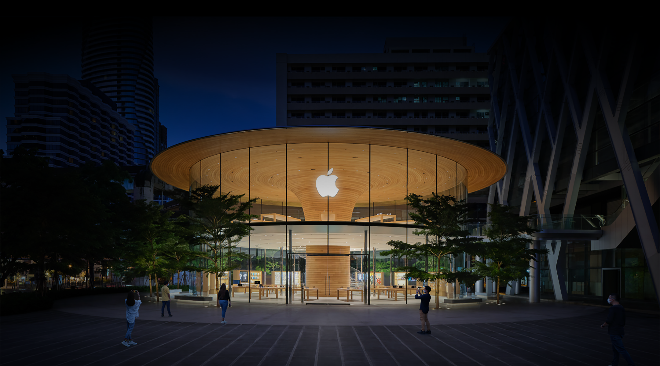 Exterior of an Apple Store location at night.