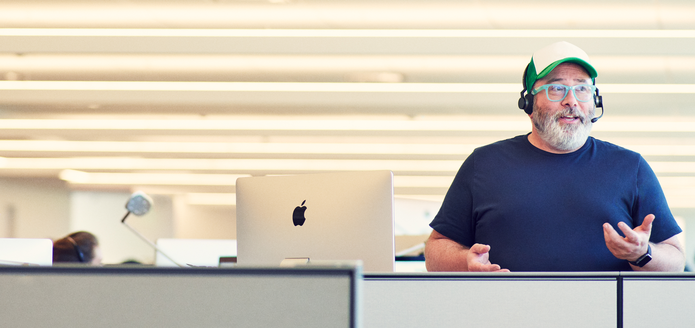 An Apple Support employee talks to a customer over the phone.