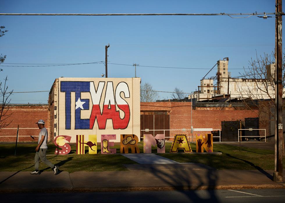 A graffitied wall in Sherman, Texas.