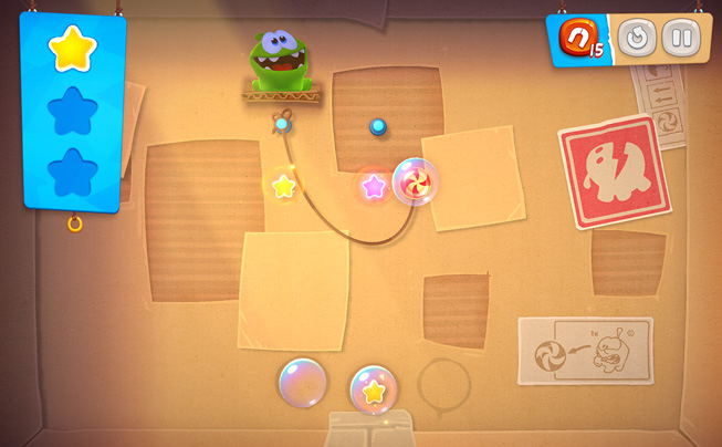 "A still from the game ""Cut the Rope Remastered."""
