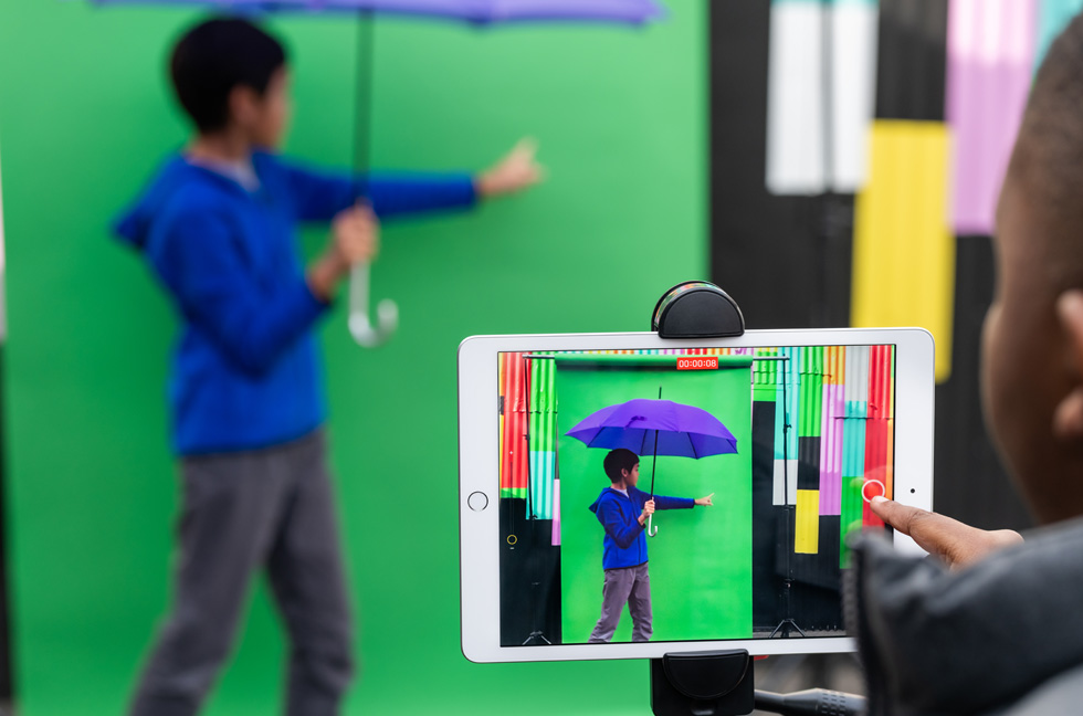 Students experiment with green-screen effects using the Everyone Can Create curriculum on iPad.
