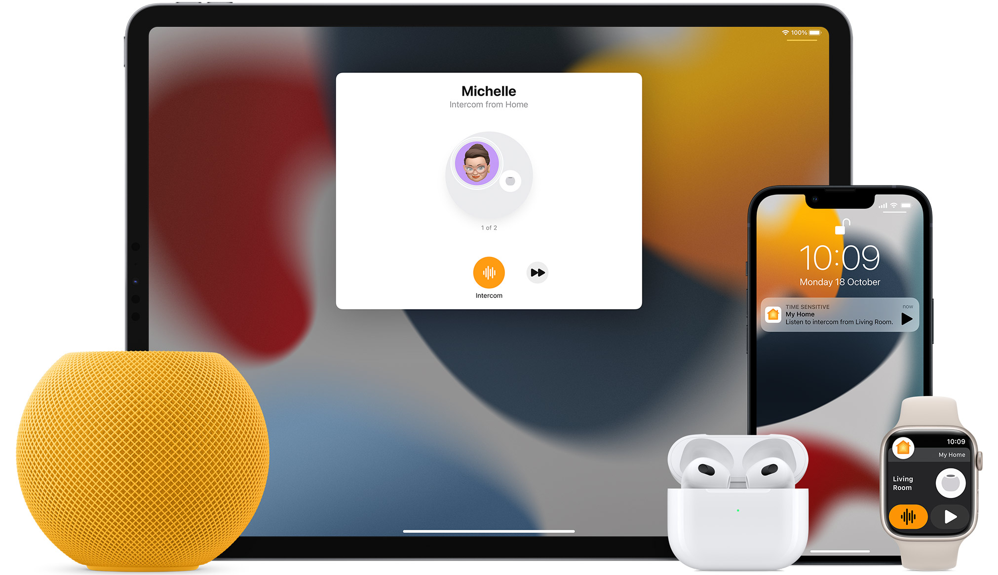 White HomePod mini, an iPad, AirPods in a case, an iPhone and an Apple Watch with a pink band are arranged.