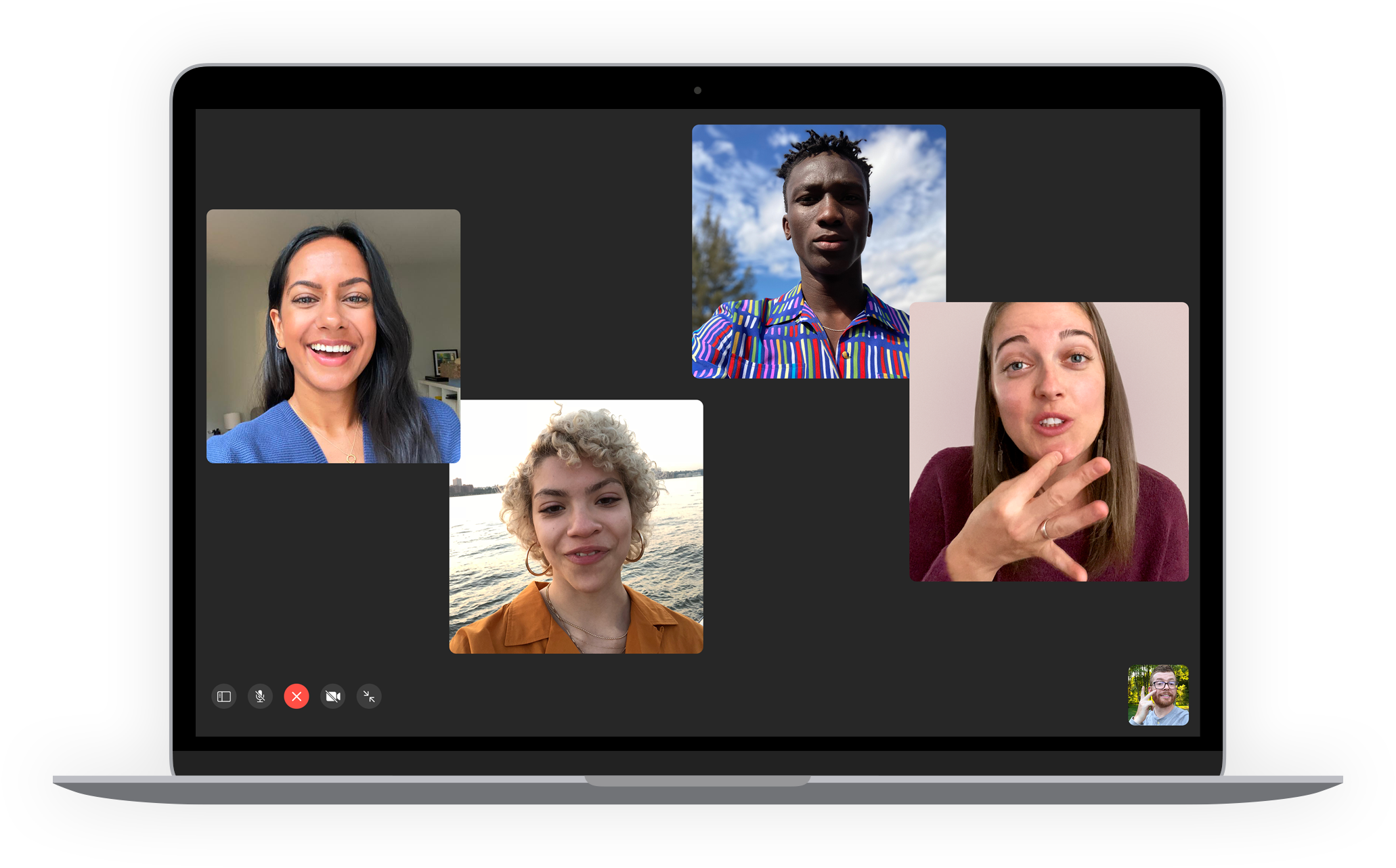 FaceTime call on MacBook with some participants using sign language.