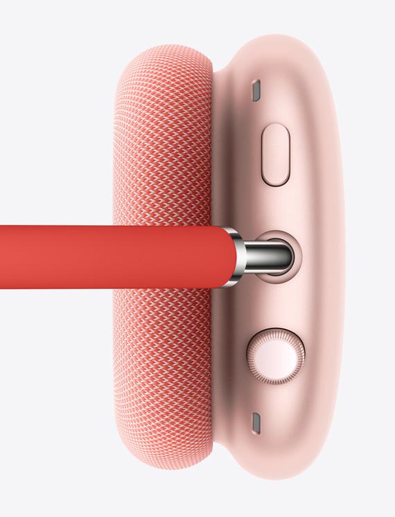 Pildil on roosa parempoolne kõrvaklapp, kus on näha diginupp DigitalCrown ja mürasummutusnupp.