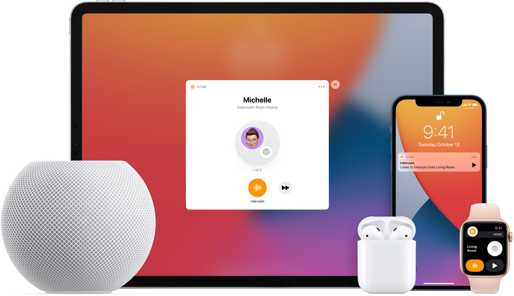 White HomePod mini, an iPad, AirPods in a case, an iPhone, and an Apple Watch with a pink band are arranged.