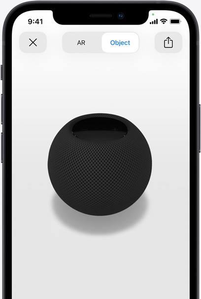 Space Gray HomePod on the screen of an iPhone in AR view.