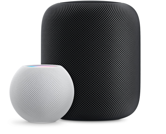 White HomePod mini in front and  to the left of a Space Gray HomePod.